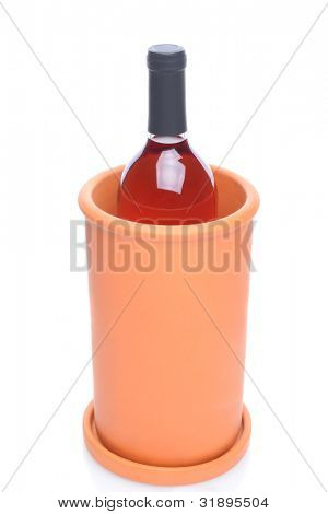 A terra cotta wine chiller with a bottle of blush wine inside. Vertical over a white background with reflection.