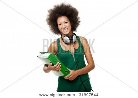 Beautiful young female student with headphones and holding a folder, isolated on white background