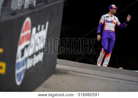 August 17, 2019 - Bristol, Tennessee, USA: Denny Hamlin (11) gets ready for the Bass Pro Shops NRA Night Race at Bristol Motor Speedway in Bristol, Tennessee.