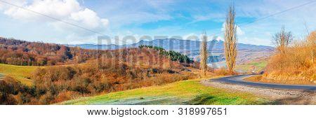 Sunny Morning In Mountainous Countryside. Panorama Of Ukrainian Carpathian Rural Area In November. L
