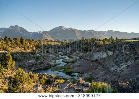 Winding Creek Of Hot Creek Geological Site In Mammoth Lakes California At Dusk Sunset, With Backligh