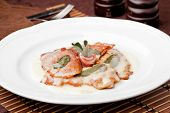 Saltimbocca - slices of veal meat with prosciutto and fresh sage leaves. poster