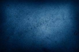 Closeup of blue textured background. Dark edges. Copy space