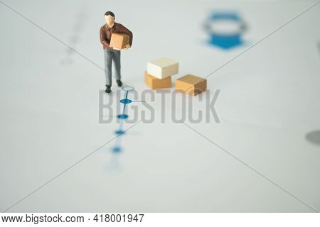 Miniature People With Parcel Standing On Tracking Status Parcel. The Concept Of Delivery Service Sta