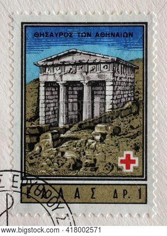ZAGREB, CROATIA - SEPTEMBER 13, 2014: Stamp printed by Greece shows Athenian Treasury, Delphi, International Red Cross series, circa 1963