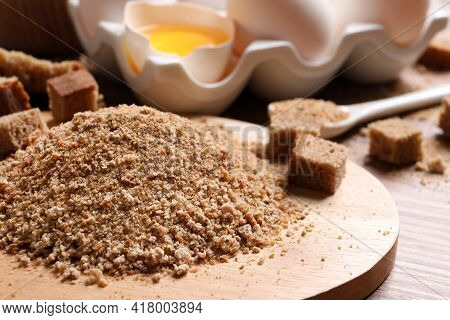 Fresh Breadcrumbs And Eggs On Table, Closeup