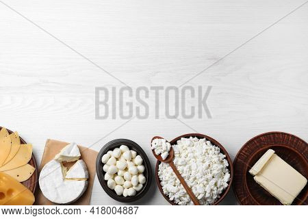 Clay Dishware With Fresh Dairy Products On White Wooden Table, Flat Lay. Space For Text