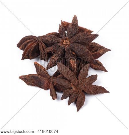Heap of anise stars isolated over white background