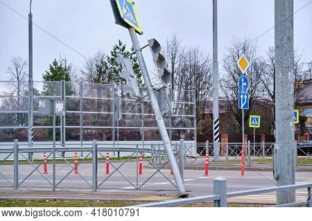 Falling Traffic Light At A Pedestrian Crossing. Security Threat. Negligence Of Road Services