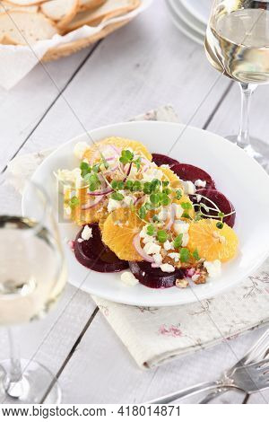 Orange Salad With Baked Beetroot, Goat Cheese, Microgreens And Nuts. Perfect As A Side Dish Or As A