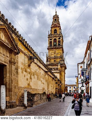 Cordoba, Andalusia, Spain - May 13, 2013:  Calle Cardenal Herrero Street With The Tower Of Mosque-ca