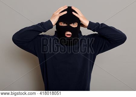 Shocked And Frightened Criminal, Thief Catching On Place Of Committing Crime, Looking At Camera With