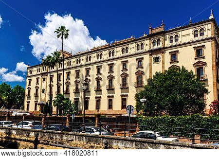 Seville, Andalusia, Spain - May 14, 2013: Eastern Facade  Historic Hotel Alfonso Xiii.