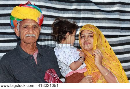 Portrait Photo With Grandfather, Grandson And Daughter-in-law Of Indian Origin