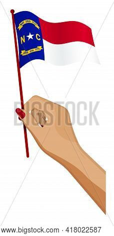 Female Hand Gently Holds Small Flag Of American State Of North Carolina. Holiday Design Element. Car