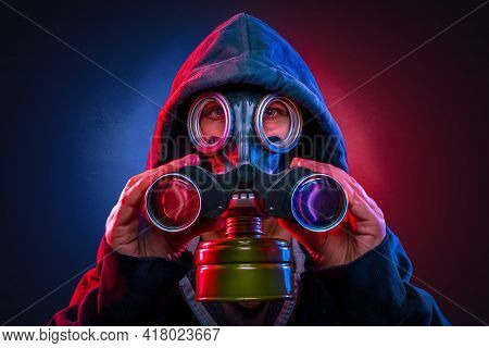Person With A Gas Mask Using A Spyglass