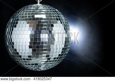 Shining Disco Ball dance music club event equipment isolated on black dark background