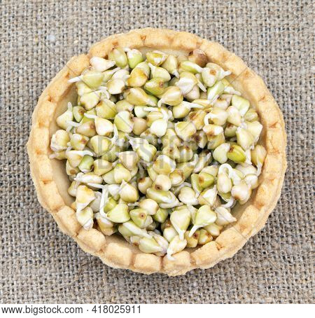 Tartlet With Sprouted Green Buckwheat On A Linen Background.healthy Food. Vegan Food. Nature Vitamin
