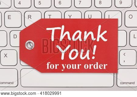 Thank You For Your Order Message On A Gift Tag On Gray Keyboard For Your Online Sales