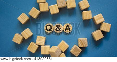 Q And A, Questions And Answers Symbol. Concept Text 'q And A, Questions And Answers' On Wooden Circl