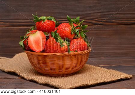 Still Life In A Rustic Style Basket With Strawberries On Sackcloth