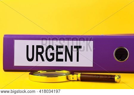 Urgent, Situation Necessary Imperative Important Concept. Purple Folder With The Words Urgent.