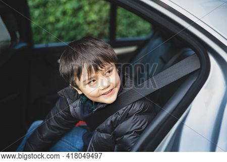 Cinematic Portrait Boy Siting In Safety Car Seat Looking At Out With Smiling Face,child Sitting In T