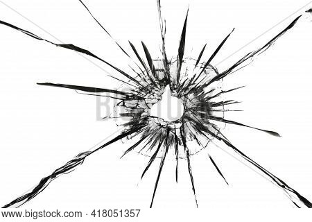 The Effect Of Cracks On Broken Glass From A Shot Of A Weapon. A Hole In The Glass Of The Bullet