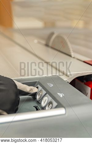 Turns On The Woodworking Machine, The Hand Of The Carpenter Starts The Woodworking Machine. Manufact