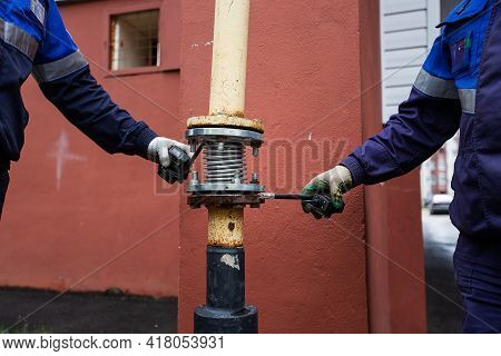 Emergency Workers Provide Safety In The Event Of A Gas Leak, Repair Of A Gas Pipeline During An Acci