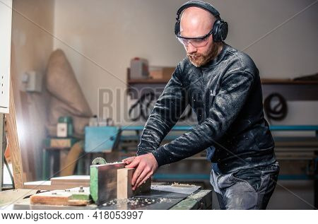 Joinery, Woodworking And Furniture Making, Professional Carpenter Cutting Wood In Carpentry Shop, In