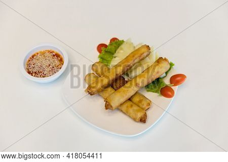 Fried Spring Rolls With Red And White Sauces. Deep Fried Spring Roll With Sauce On White Plate. Cris