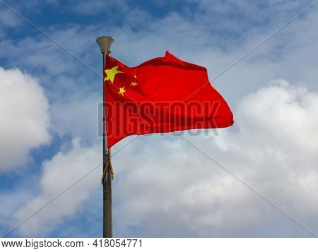 National Flag Of China Or Officially The People's Republic Of China Prc Strong Waving In The Wind On