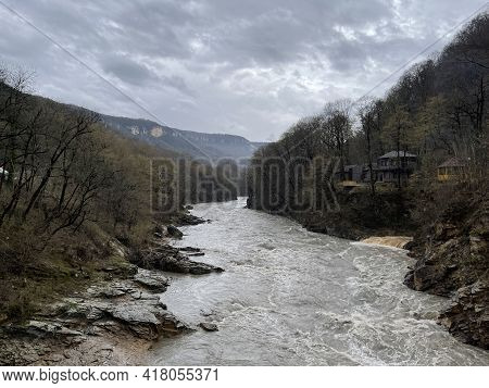 Beautiful Landscape Of Mountain River In Amazing And Mysterious Nature. Mountain Waterway Flowing Th
