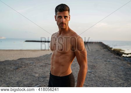 Sexy Shirtless Young Italian Man With Muscular Body Posing Outdoors Shirtless.