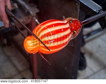 Hands Shaping Melted Glass With Long Knife Jack. Art And Craft Worker Molding Glass While Blowing Ar
