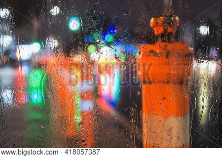 Rainy Weather And Raindrops On The Glass.