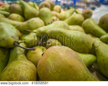 Selling Pears In A Grocery Supermarket Close Up.
