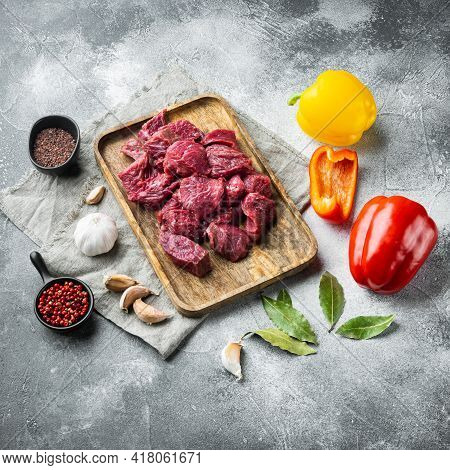 Fresh Beef Chunks Served On Table With Ingredients Ready For Cooking Set With Sweet Bell Pepper, On