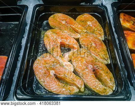 Fillet Of Red Fish Marinated With Spices For Cooking.