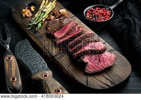Slices Of Medium Rare Grilled Marbled Meat Beef Steak Set, Tenderloin Or Fillet Mignon Cut, On Woode