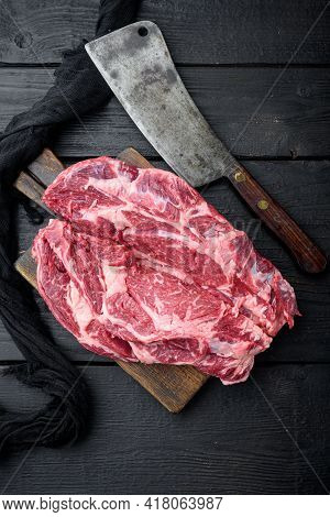 Rib Eye Steak Of Beef Marbled Meat Or Scotch Fillet Set, And Old Butcher Cleaver Knife, On Black Woo