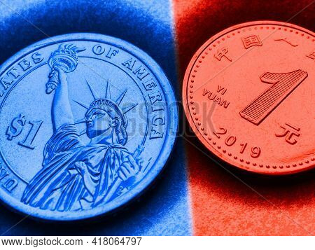 Translation: People's Bank Of China, One Yuan. 1 American Dollar And 1 Chinese Yuan Coins. Blue And