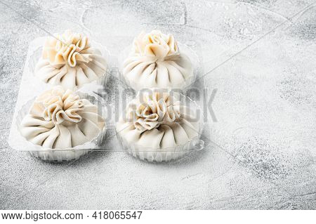 Manti, Turkish Traditional Ravioli Set, In Plastic Tray, On Gray Stone Background, With Copy Space F