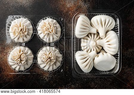 Manti Or Manty Dumplings, Popular Asian Dish Set, In Plastic Tray, On Old Dark Rustic Background, To