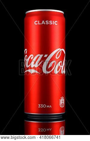 Moscow, Russia - April 07, 2021: Coca-cola Classic In Red Aluminum Can With Reflection On Glossy Sur