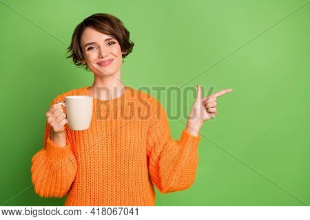 Photo Of Young Attractive Lovely Happy Smiling Girl Drink Tea Point Fingers Copyspace Isolated On Gr