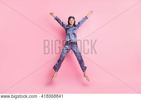 Full Length Body Size Photo Of Girl Wearing Blue Nightwear Jumping Playful Like Star Smiling Isolate