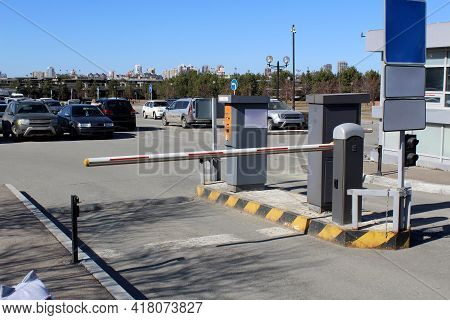 Closed Barrier In A Paid Parking Lot, Warm Sunny Day