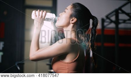 Athlete Asian Woman Drinking Pure Water After Workout Exercise Or Training Building Muscles And Burn